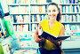 Woman reading textbook in shop, фото № 23861964, снято 20 октября 2016 г. (c) Яков Филимонов / Фотобанк Лори