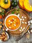 Овощной суп из тыквы с сухариками на столе. Вид сверху, фото № 23874304, снято 20 октября 2016 г. (c) Надежда Мишкова / Фотобанк Лори