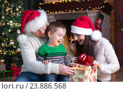 Купить «holidays, presents, christmas concept - happy mother, father and child boy with gift box», фото № 23886568, снято 16 января 2016 г. (c) Оксана Кузьмина / Фотобанк Лори