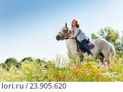 Купить «Portrait of beautiful woman hugging white horse», фото № 23905620, снято 3 июля 2016 г. (c) Сергей Новиков / Фотобанк Лори