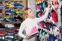 Girl choosing shoes in store, фото № 23906800, снято 24 октября 2016 г. (c) Яков Филимонов / Фотобанк Лори