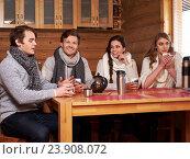 Купить «Best friends drinking hot tea in cosy kitchen at winter cottage», фото № 23908072, снято 15 января 2016 г. (c) Andrejs Pidjass / Фотобанк Лори