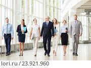 Купить «business people walking along office building», фото № 23921960, снято 3 июля 2016 г. (c) Syda Productions / Фотобанк Лори