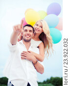 couple with colorful balloons at sea side, фото № 23922032, снято 14 июля 2013 г. (c) Syda Productions / Фотобанк Лори