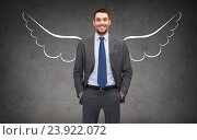 Купить «happy businessman with angel wings over gray», фото № 23922072, снято 17 ноября 2018 г. (c) Syda Productions / Фотобанк Лори