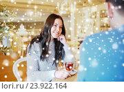Купить «happy couple drinking tea at cafe», фото № 23922164, снято 23 января 2016 г. (c) Syda Productions / Фотобанк Лори