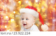 Купить «baby boy in christmas santa hat over blue lights», фото № 23922224, снято 22 мая 2014 г. (c) Syda Productions / Фотобанк Лори