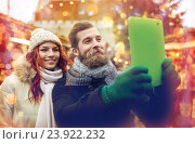 couple taking selfie with tablet pc in old town, фото № 23922232, снято 11 декабря 2014 г. (c) Syda Productions / Фотобанк Лори