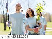 Купить «group of volunteers with trees and rake in park», фото № 23922308, снято 7 мая 2016 г. (c) Syda Productions / Фотобанк Лори