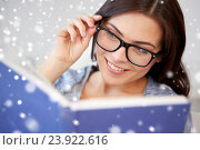 Купить «happy woman in glasses reading book at home», фото № 23922616, снято 23 марта 2016 г. (c) Syda Productions / Фотобанк Лори