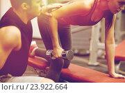 Купить «close up of couple with dumbbell exercising in gym», фото № 23922664, снято 30 ноября 2014 г. (c) Syda Productions / Фотобанк Лори