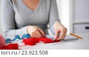 Купить «woman knitting with needles and red yarn», видеоролик № 23923508, снято 22 октября 2016 г. (c) Syda Productions / Фотобанк Лори