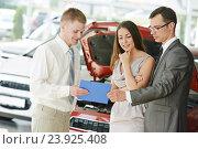 Купить «Automobile shopping. Family buying auto car», фото № 23925408, снято 18 мая 2013 г. (c) Дмитрий Калиновский / Фотобанк Лори