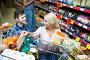 Couple choosing cheese at shop, фото № 23957656, снято 27 октября 2016 г. (c) Яков Филимонов / Фотобанк Лори