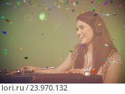 Купить «Composite image of pretty female dj playing music», фото № 23970132, снято 19 марта 2019 г. (c) Wavebreak Media / Фотобанк Лори