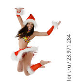 Сексуальная девушка в новогоднем костюме прыгает, фото № 23971284, снято 1 декабря 2012 г. (c) Евгений Захаров / Фотобанк Лори