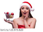 Купить «Santa girl with shopping cart and christmas decoration», фото № 23973820, снято 29 сентября 2016 г. (c) Elnur / Фотобанк Лори