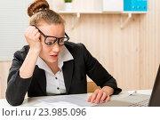Купить «Tortured accountant with glasses creates financial statements for the past year», фото № 23985096, снято 13 февраля 2016 г. (c) Константин Лабунский / Фотобанк Лори