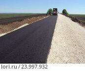 Купить «Строительство автодороги летом в поле», фото № 23997932, снято 19 мая 2014 г. (c) Юрий Серебряков / Фотобанк Лори