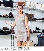 Купить «Happy brunette posing with bags in footwear shop», фото № 23998668, снято 26 сентября 2016 г. (c) Яков Филимонов / Фотобанк Лори
