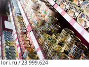 Купить «Canned and tinned products in Russian food store», фото № 23999624, снято 2 февраля 2016 г. (c) Яков Филимонов / Фотобанк Лори