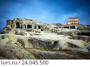 Купить «Uplistsikhe. Rock cave city with christian basilica church in Georgia», фото № 24045500, снято 29 октября 2016 г. (c) Дмитрий Калиновский / Фотобанк Лори