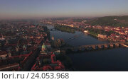 Купить «Aerial view of the old part of Prague and bridges over the Vltava river at sunrise. Charles bridge. Urban landscape», видеоролик № 24053968, снято 22 сентября 2016 г. (c) Данил Руденко / Фотобанк Лори
