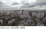 Купить «Aerial view of one of the districts of Moscow, cloudy weather. Urban cityscape from quadrocopter», видеоролик № 24081444, снято 22 сентября 2016 г. (c) Данил Руденко / Фотобанк Лори