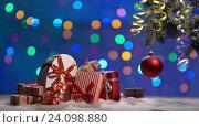 Купить «Christmas ball and a fir branch with gift box on a wooden background with snowing and lighten bokeh hotspot», видеоролик № 24098880, снято 30 октября 2016 г. (c) Анатолий Типляшин / Фотобанк Лори