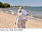 Купить «happy senior couple hugging on summer beach», фото № 24131064, снято 18 августа 2015 г. (c) Syda Productions / Фотобанк Лори