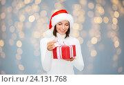 Купить «smiling woman in santa helper hat with gift box», фото № 24131768, снято 15 августа 2013 г. (c) Syda Productions / Фотобанк Лори