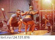Купить «man and woman with bar flexing muscles in gym», фото № 24131816, снято 19 апреля 2015 г. (c) Syda Productions / Фотобанк Лори