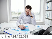 Купить «stressed businessman with papers in office», фото № 24132088, снято 18 июня 2015 г. (c) Syda Productions / Фотобанк Лори