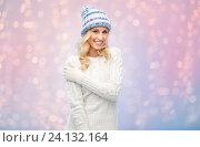 Купить «smiling young woman in winter hat and sweater», фото № 24132164, снято 8 октября 2015 г. (c) Syda Productions / Фотобанк Лори