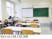 Купить «school classroom with desks and blackboard», фото № 24132308, снято 14 ноября 2014 г. (c) Syda Productions / Фотобанк Лори