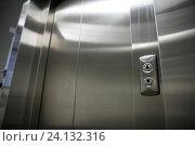 Купить «elevator or lift closed metal doors and buttons», фото № 24132316, снято 15 апреля 2015 г. (c) Syda Productions / Фотобанк Лори