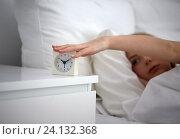 Купить «close up of woman with alarm clock in bed at home», фото № 24132368, снято 30 апреля 2016 г. (c) Syda Productions / Фотобанк Лори