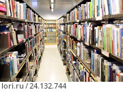 bookshelves with books at school library, фото № 24132744, снято 18 февраля 2015 г. (c) Syda Productions / Фотобанк Лори