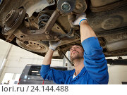 mechanic man or smith repairing car at workshop. Стоковое фото, фотограф Syda Productions / Фотобанк Лори