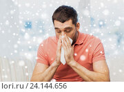 Купить «sick man blowing nose to paper napkin at home», фото № 24144656, снято 15 января 2016 г. (c) Syda Productions / Фотобанк Лори