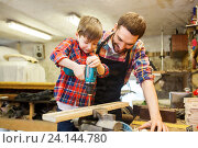Купить «father and son with drill working at workshop», фото № 24144780, снято 14 мая 2016 г. (c) Syda Productions / Фотобанк Лори