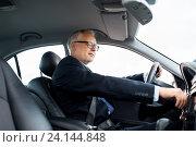 Купить «happy senior businessman starting car and driving», фото № 24144848, снято 16 июля 2016 г. (c) Syda Productions / Фотобанк Лори