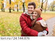 happy young couple hugging in autumn park. Стоковое фото, фотограф Syda Productions / Фотобанк Лори