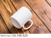 Чашка на столе. Стоковое фото, фотограф ouh_desire / Фотобанк Лори