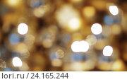 Купить «blurred golden christmas lights bokeh», видеоролик № 24165244, снято 3 ноября 2016 г. (c) Syda Productions / Фотобанк Лори