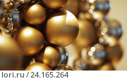 Купить «golden christmas decoration or garland of beads», видеоролик № 24165264, снято 3 ноября 2016 г. (c) Syda Productions / Фотобанк Лори