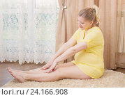 Купить «happy pregnant woman exercising and stretching at home», фото № 24166908, снято 5 мая 2016 г. (c) Майя Крученкова / Фотобанк Лори