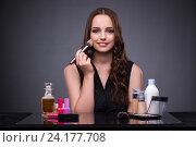 Купить «Beautiful woman applying make-up in fashion concept», фото № 24177708, снято 7 сентября 2016 г. (c) Elnur / Фотобанк Лори