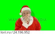 Купить «Santa claus with finger on lips», видеоролик № 24196952, снято 15 сентября 2019 г. (c) Wavebreak Media / Фотобанк Лори