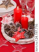 Купить «Новогодний декор со горящими свечами, шишками, звездами на столе», фото № 24197716, снято 9 ноября 2016 г. (c) Елена Лобовикова / Фотобанк Лори